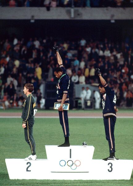 Australia's Peter Norman (left),  Tommie Smith and John Carlos of Team USA raise their fists for racial equality on the medal stand after winning the 200-meter gold during the 1968 Summer Olympics at Estadio Olimpico, Mexico City, Mexico.