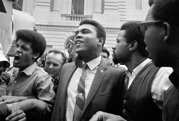Muhammad Ali, centre, leaving the Armed Forces Induction Center in Houston, with his entourage, after refusing to be drafted for the war in Vietnam. 	Picture: Associated Press