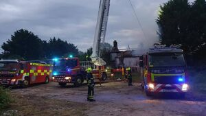 Latest: Cork City Fire Service use aerial platform as they continue to battle house fire