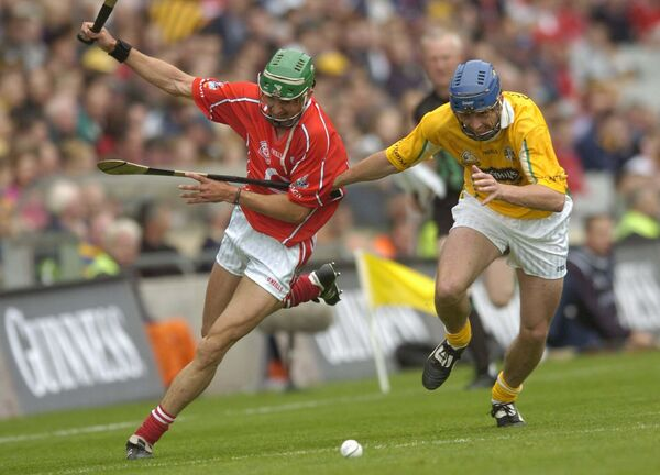 Jonathan O'Callaghan holding off Antrim player Michael McCambridge in 2004. Picture: Dan Linehan