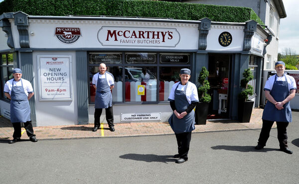 Staff at McCarthy's Family Butchers continuing with business at Bishopstown, Cork, (from left) Sean Olden, Chris Hourigan, manager; Gwen McIntyre and Brian McCarthy.Picture Denis Minihane.
