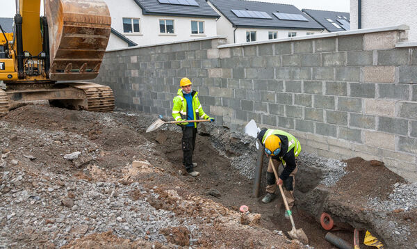 Kyle Power and Patrick Madded practice social distancing while carrying out ground works at the Astra construction site in Janeville, Carrigaline.