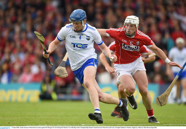 Austin Gleeson of Waterford takes on Patrick Horgan. Picture: Matt Browne/Sportsfile