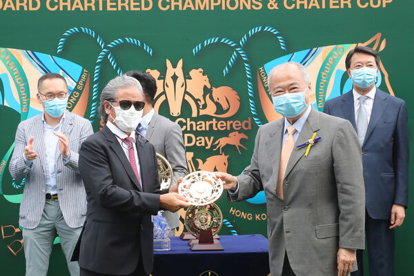 Exultant winning trainer Tony Cruz accepts his trophy from HKJC Steward Sir C K Chow after back-to-back wins in the G1 Standard Chartered Champions & Chater Cup. Picture: Healy Racing.