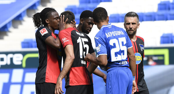 Hertha's Belgian defender Dedryck Boyata, left, talks to teammate Serbian midfielder Marko Grujic during their Bundesliga match against TSG 1899 Hoffenheim in Sinsheim, Germany. Boyata got some criticism for getting too close to his teammate. 	Picture:Thomas Kienzle/AFP pool via AP)