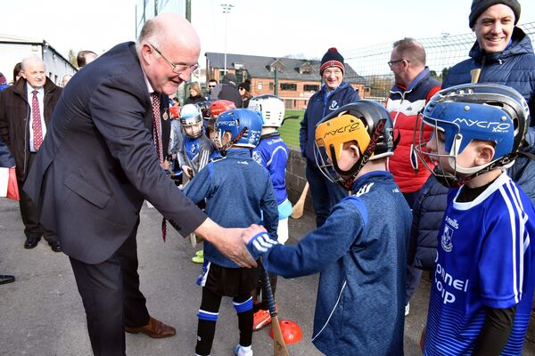 GAA President, John Horan, being greeted by young Sars players at the opening of the Eddie O'Connell All Weather Hurling Complex. in February. Picture: Mike English