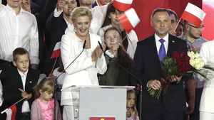 Incumbent claims victory in tight race for Poland's presidency