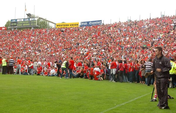Fans had to be allowed onto the pitch after the terrace overflowed in 2008 in the Cork and Tipp Munster championship clash. Picture: Larry Cummins