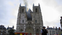 Arson inquiry launched as French firefighters battle blaze in Nantes cathedral