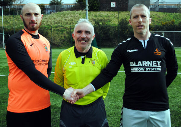 Grangevale captain Colin McKeown (right) welcomes Innishvilla B's captain Darragh Murphy, watched by referee Tony Thompson, earlier this season. Picture: Barry Peelo.