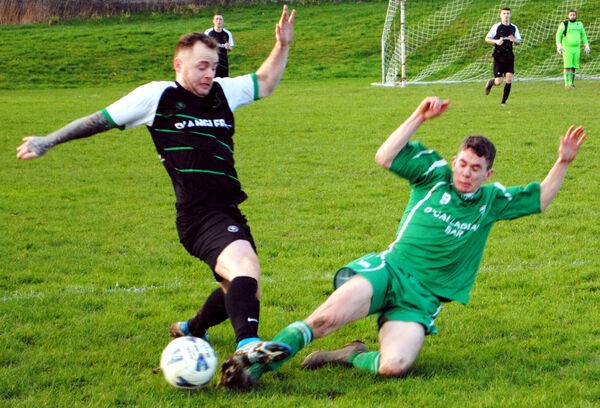 Coachford's Ian Barry Murphy gets in his challenge on Knocknaheeny Celtic's Christy Driscoll. Picture: Barry Peelo.