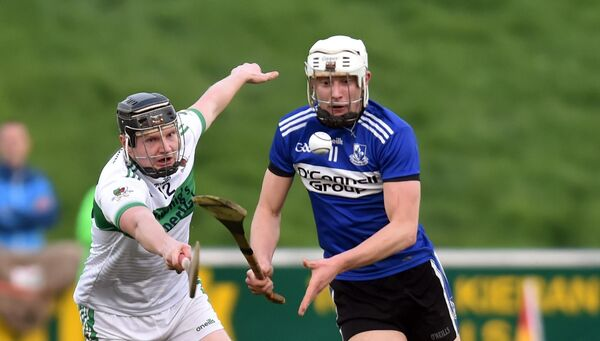 Sarsfields' Aaron Myers Kanturk's Ryan Walsh tussle for the ball last year. Picture: Eddie O'Hare