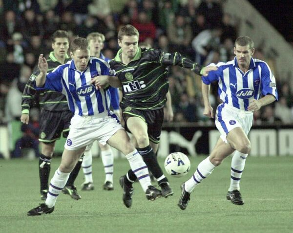 Kilmarnock Mark Reilly left and Ian Durrant battle Celtic's Colin Healy in 2000. Picture: David Cheskin