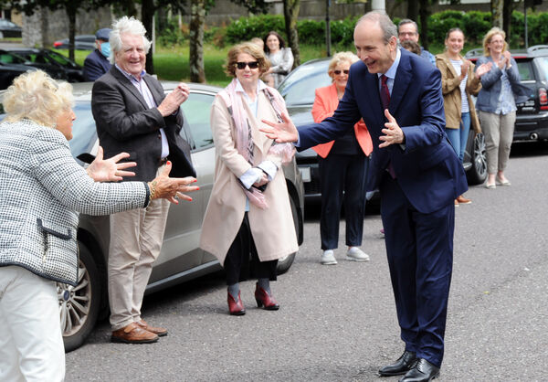 A socially distanced greeting for An Taoiseach, Micheál Martin, T.D., as he arrived back to Ballinlough in Cork.Picture Denis Minihane.