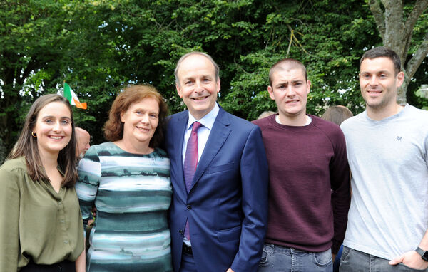 An Taoiseach, Micheál Martin, T.D., with his wife Mary and family Micheál Aodh, Aoibhe and Cillian on his return home to Ballinlough in Cork.Picture Denis Minihane.