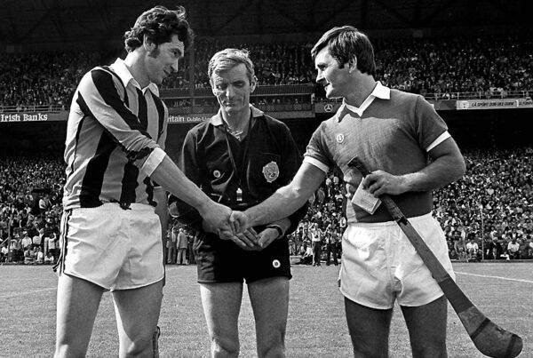 Rival captains Ger Henderson, Kilkenny, and Charlie McCarthy shake hands, watched by referee Jimmy Rankins, at Croke Park on September 3, 1978.