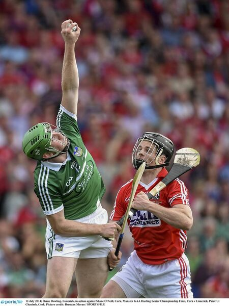 Shane Dowling, Limerick, in action against Shane O'Neill, Cork, in the 2014 Munster final in Páirc Uí Chaoimh. Picture: Brendan Moran/SPORTSFILE