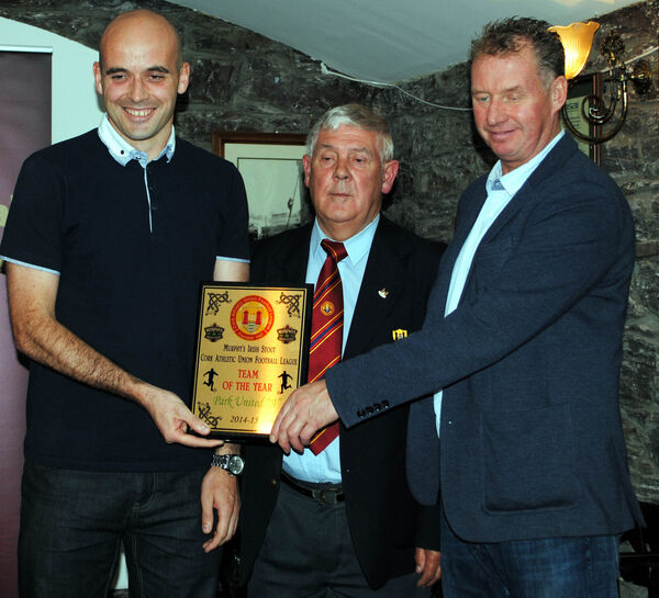 Mick Barrett, the captain of Park United A, is presented with the Team of the Year award from Ted O'Mahony for 2014-15, along with Jim Cashman (Heineken Ireland). Picture: Barry Peelo.