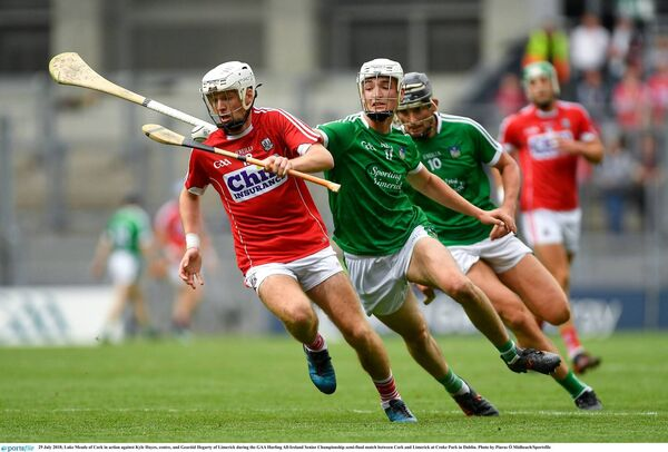 Luke Meade of Cork in action against Kyle Hayes and Gearóid Hegarty of Limerick. Picture: Piaras Ó Mídheach/Sportsfile