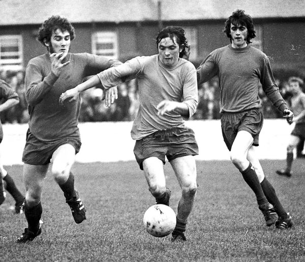 Cork Celtic's ball artist Carl Humphries jinks his way past Shelbourne defenders Dunning and McDonnell in  1971.