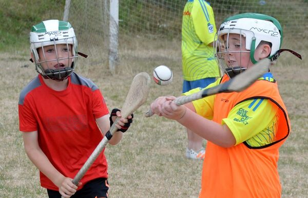 This year's Ballincollig Cúl Camp has been called off. Kaden Coomey, right, hurling with Cal McCarthy. Picture: Denis Minihane.