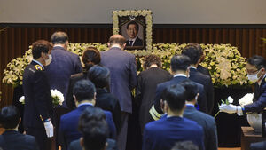 Condolences and insults as Seoul mayor's funeral held online