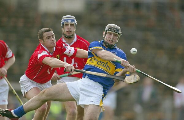 Eoin Kelly of Tipperary tackled by Cork's Mark Prendergast. Picture: INPHO/Lorraine O'Sullivan