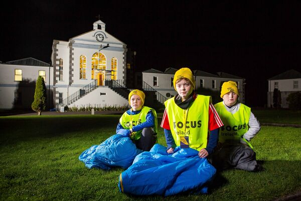 "Michaeál Mulhern, Cuil Aodha; Adam Spillane, Midleton, and Aaron Hull, Midleton, pictured at the Focus Ireland ""Shine A Light"" Sleep out at Spike Island last year.Picture: Michael O'Sullivan /OSM PHOTO"