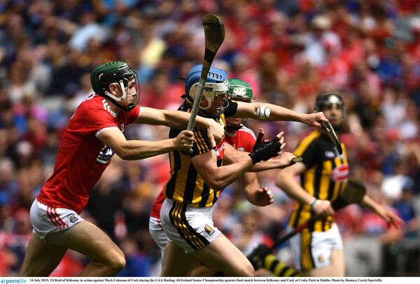 TJ Reid of Kilkenny battling Mark Coleman of Cork in the 2019 All-Ireland hurling quarter-final at Croke Park. Picture: Ramsey Cardy/Sportsfile