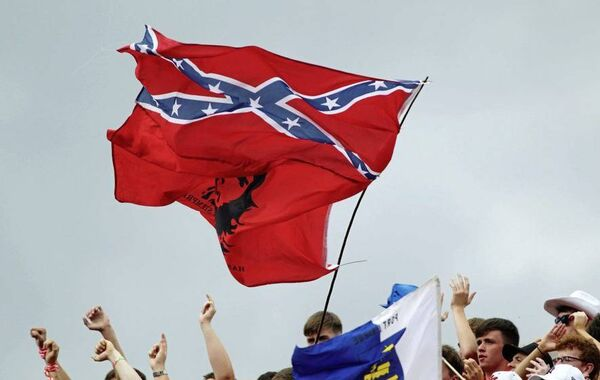 The Confederate flag flies from the same pole as revolutionary Che Guevara at Croke Park in 2006.