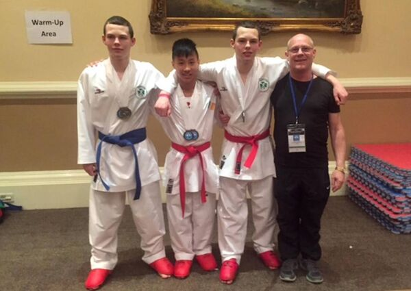 Chris McCarthy, Hieu Power, Sean McCarthy and coach Stephen O'Callaghan of the Cloghroe Karate Club after a triumphant performance at the Recchia-Small International Cup in Dublin.