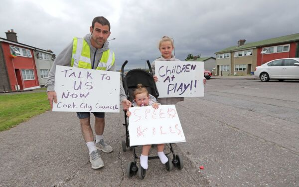 Paul Murray, whose young son Cillian, was hit by a car on Tuesday protesting with his daughters, Madison and Ellie.Picture: Jim Coughlan.