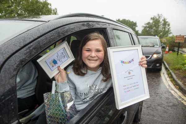Pupil Leah Flynn who graduated at the drive-by graduation cermony for the pupils of Scoil Éanna, Montenotte, Cork. Picture Dan Linehan