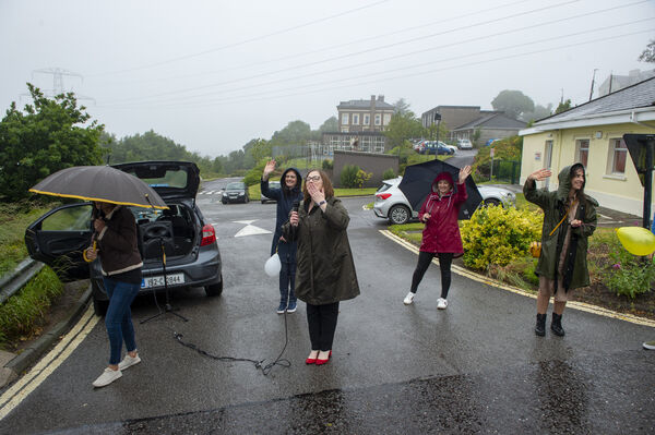 School principal Elaine Angland and the teachers saying goodbye to the pupils at the drive-by graduation cermony for the pupils of Scoil Éanna, Montenotte, Cork. Picture Dan Linehan