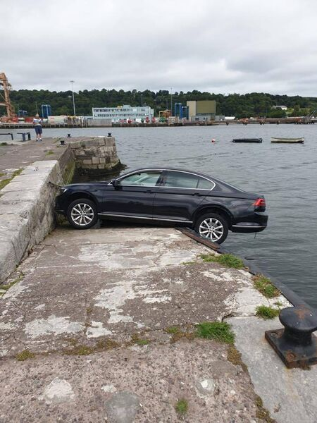 Fire service were called to assist when a car came close to falling into the water at Blackrock Pier. Pics: Cork City Fire Service.