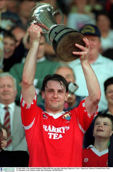 Cork captain Steven O'Brien lifts the Munster football trophy. Picture: Ray McManus/SPORTSFILE