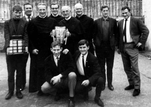 The Liam McCarthy Cup at Greenmount in 1966. Back: Gerald McCarthy who captained Cork in 1966, accompanied by Peter Doolan, Tom O'Donoghue, Tony Connolly and Charlie McCarthy. Pictured in back row are Liam McGrath, and brothers Justin, Walter, Conleth and Ailbe.
