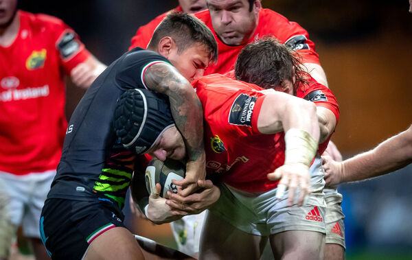 Munster's Chris Cloete with Pierre Bruno of Zebre