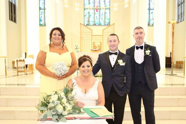 Pamela and Roy signing the register at the North Cathedral. Pictures: Ray Terry Photography