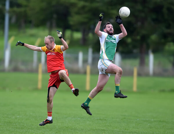 Delanys' Danny Aherne wins the ball from Tadgh MacCarthaigh's Shane O'Driscoll. Picture: Eddie O'Hare