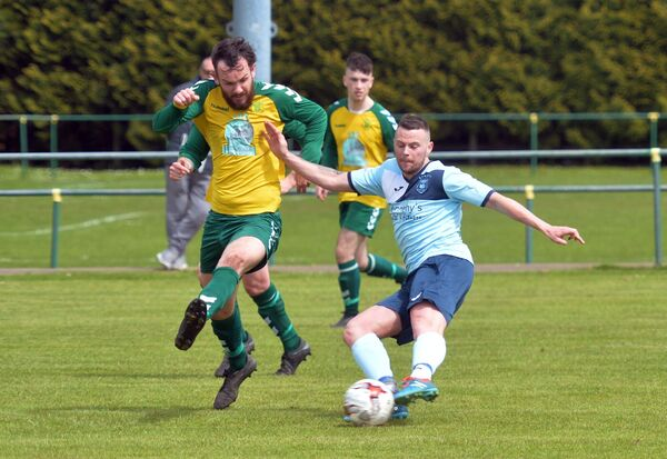 Rockmount's Danny Aherne trying to block a shot by Avondale United's Jamie Murphy. Picture: Denis Minihane.