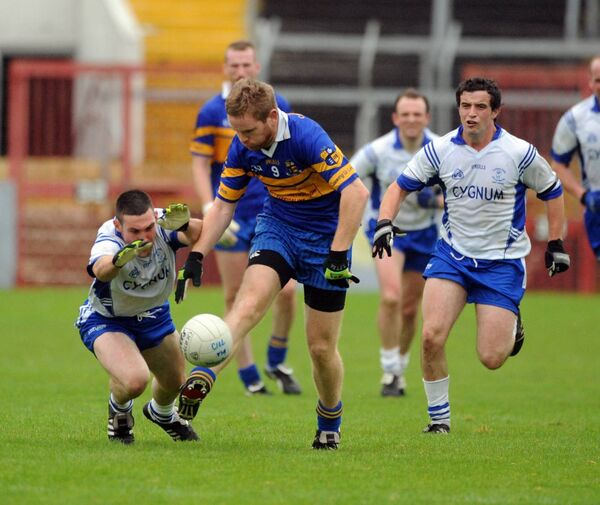 Carrigaline's Joe Moran is tackled by Cill Na Martra's Noel O'Leary. Picture: Eddie O'Hare