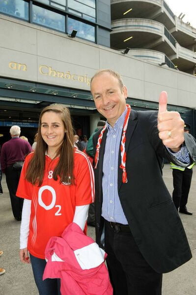 Micheál Martin, leader of the FF party and his daughter Aoibhe at the All-Ireland hurling final between Cork and Clare at Croke Park, Sept. 8, 2013. /Pic: Brian Lougheed