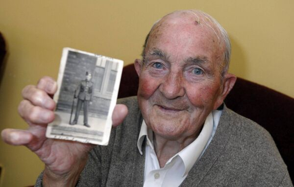 The late Paddy Martin, father of Micheál Martin with a photograph when he was a young man in the army in 1940
