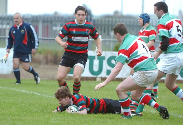 Highfield out-half Conor Quaid scores the opening try against Sunday's Well in 2008. Picture: Larry Cummins