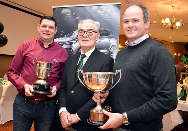 Mark Smyth and Michael Morgan, manager and captain, respectively, of Nemo Rangers' junior B football team, pictured with president, John O'Neill, at the club's victory dinner.Picture: Mike English