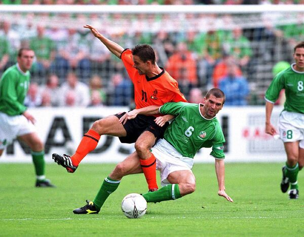 Roy Keane of Ireland tackles Marc Overmars of Holland. Picture: INPHO/Billy Stickland