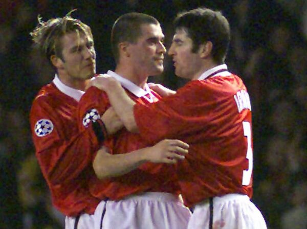 Roy Keane is congratulated by David Beckham and Denis Irwin after scoring. Picture: AP Photo/Louisa Buller