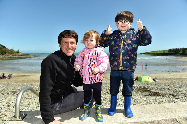 Keith Espey with his children Alan and Emma from Minane Bridge enjoying the sunshine at Fountainstown beach in Co. Cork yesterday.Picture: Eddie O'Hare