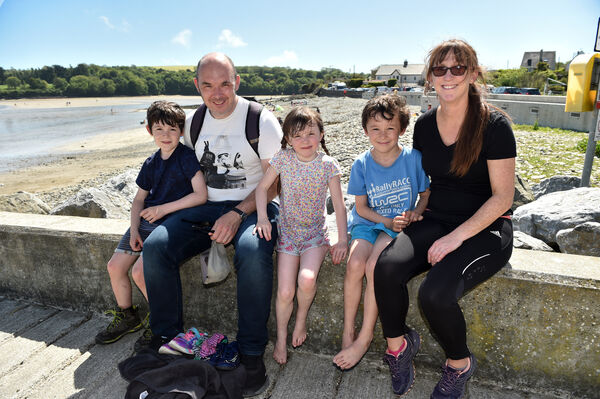 Sinead and Eamon McDaid with their children Brian, Hannah and Finn from French Furs enjoying the sunshine at Fountainstown beach in Co. Cork yesterday.Picture: Eddie O'Hare